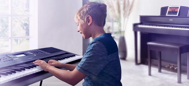 Boy playing electric keyboard