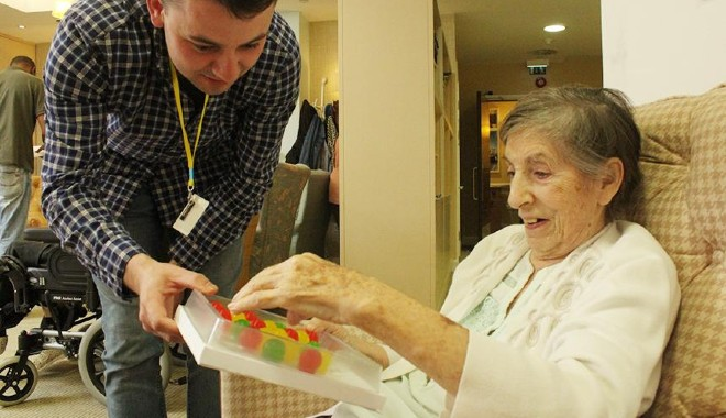 A man offering Jelly Drops in a care home