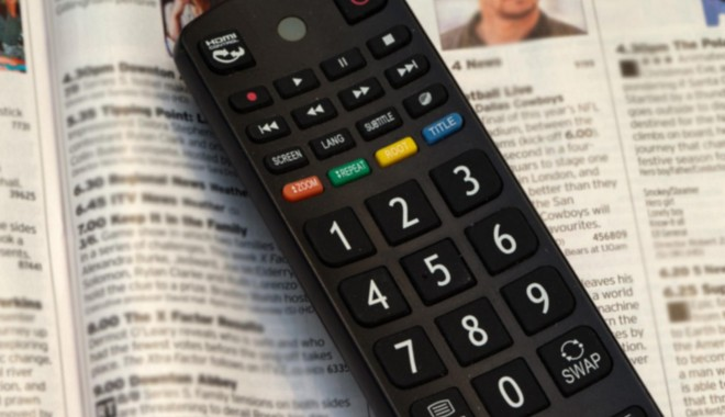 A TV remote and listings
