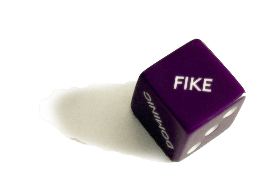 Dice with Dominic Fike written on it